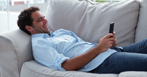 Source: http://ak6.picdn.net/shutterstock/videos/5935634/preview/stock-footage-casual-man-lying-on-the-sofa-sending-a-text-message-at-home-in-the-living-room.jpg